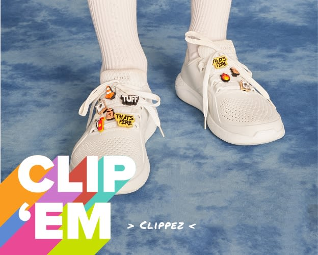 Model posing with White LiteRide Pacers with Jibbitz - image text reads 'Clip 'Em' & 'Loves Crocs and Jibbitz Charms'