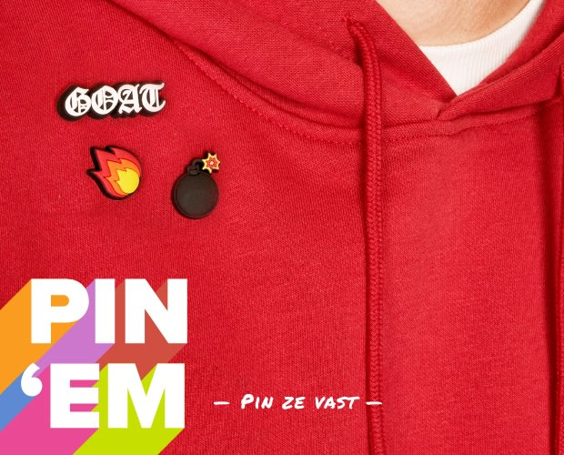 Model posing wearing red sweatshirt with Jibbitz pinned - image text reads 'Pin 'Em' & 'Loves Crocs and Jibbitz Charms'
